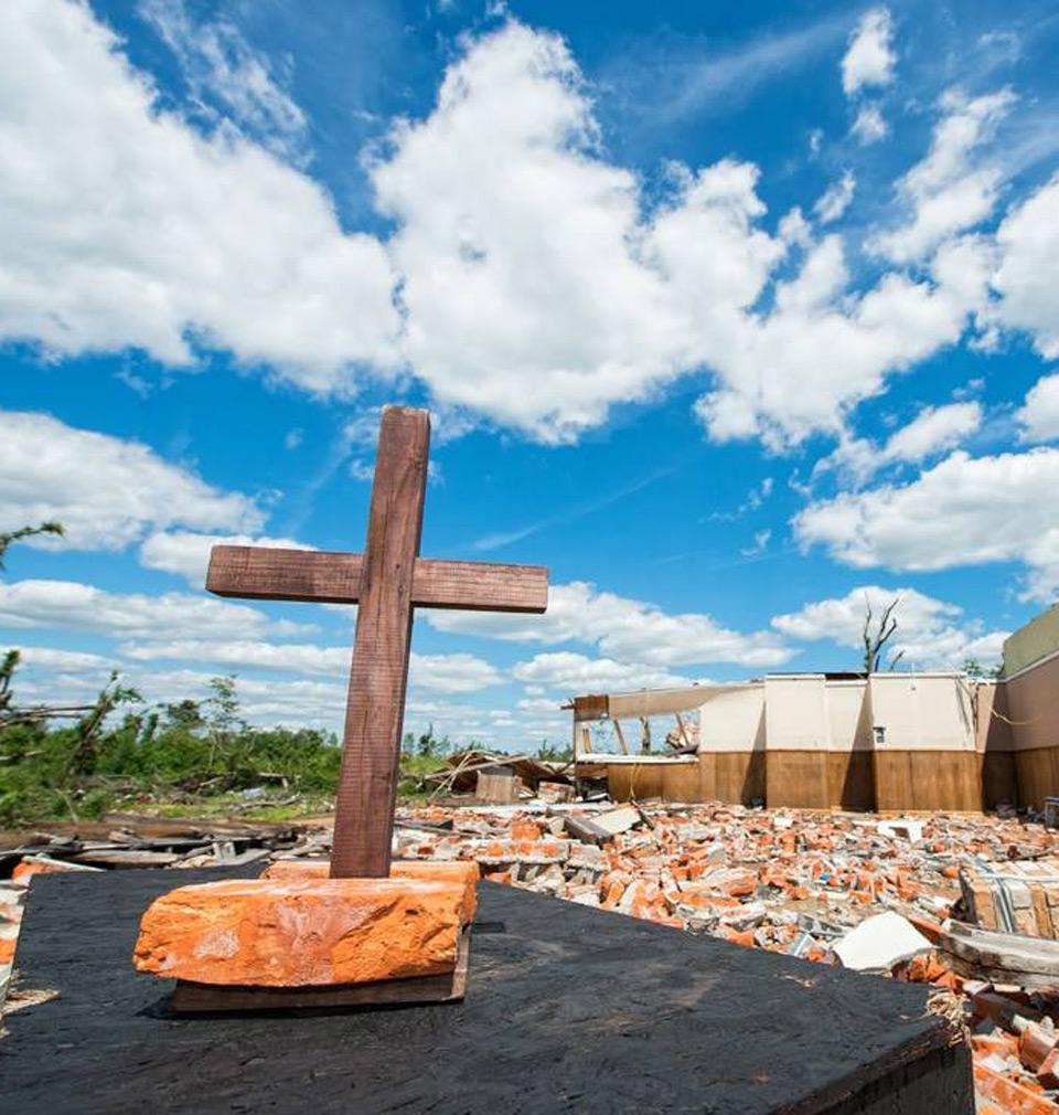 handmade cross standing in storm destruction