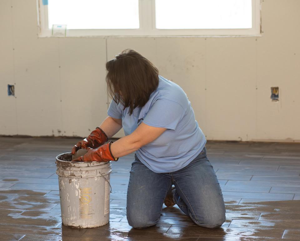 volunteer cleaning floor